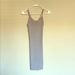 Mini knit grey dress with tie detailing on back